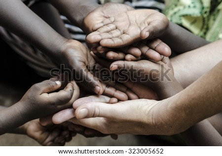 African Hands Cupped (World Social Issues) Health Problems Symbol. African Children in developing countries suffer most from this problem, that causes malnutrition and health problems. - stock photo
