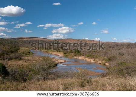 African landscape in the Hluhluwe National Park, South Africa. / River in dry season. - stock photo