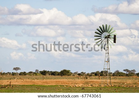 African landscape with a big wind turbine for electricity - stock photo