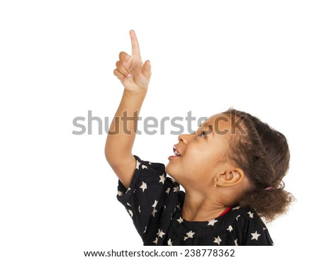 African little girl pointing her finger up, isolated on white - stock photo