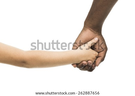 African male and caucasian child holding hands - stock photo