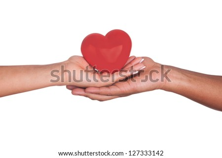 african Man and woman holding red heart in hands isolated on white