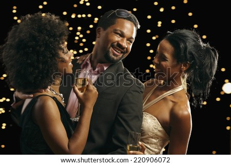 African man dancing with two women - stock photo