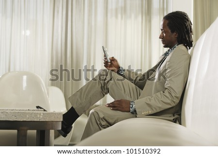 African man dialing cell phone - stock photo