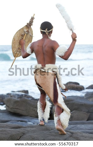 african man dressing in traditional clothes on beach - stock photo