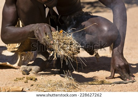 African man making fire in the traditional way, South Africa - stock photo