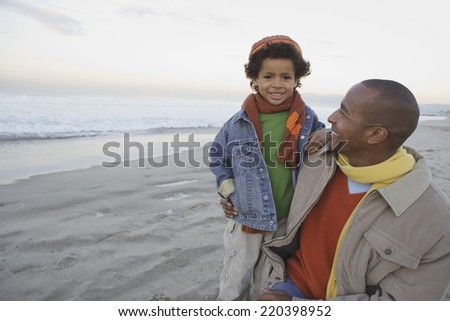 African man with son on the beach