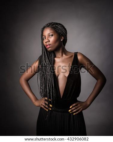 african model alluring, dark background - stock photo