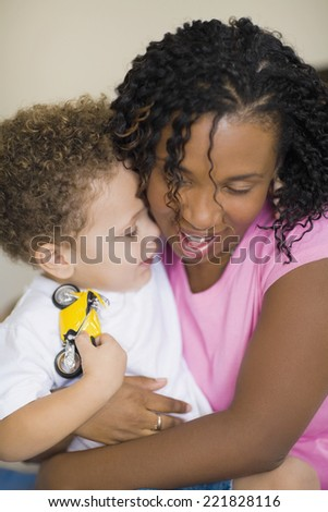 African mother hugging child - stock photo
