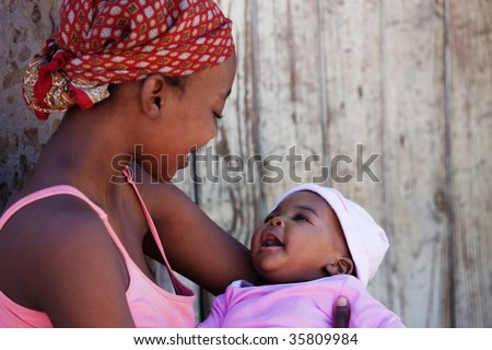 African mother with baby girl, location Mmankgodi village , Botswana - stock photo