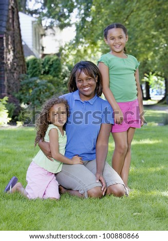 African mother with two young daughters outdoors