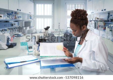 African scientist, medical worker, tech or graduate student works in modern biological laboratory