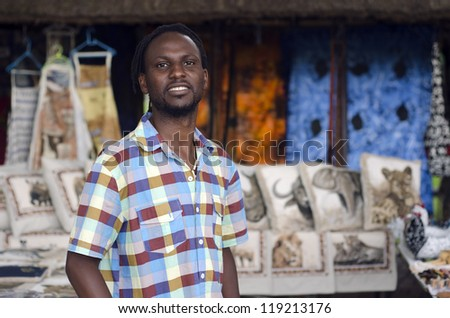 African small business curio salesman selling ethnic items in Howick, KwaZulu-Natal South Africa - stock photo