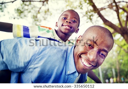 African Son Dad Piggy Back Family Outdoors Concept - stock photo