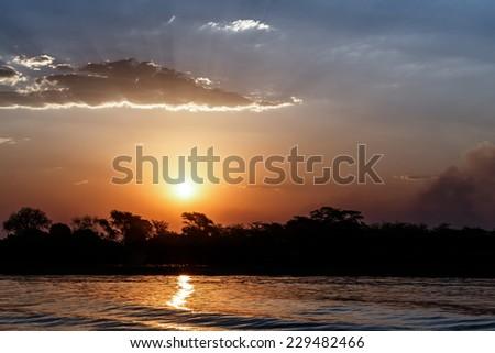 African sunset on Chobe river, Chobe National Park, Botswana - stock photo