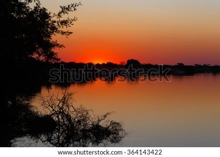 African sunset on Zambezi river, Caprivi strip region, Namibia - stock photo