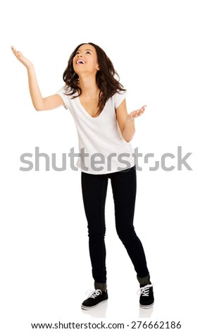 African teen woman holding copyspace. - stock photo