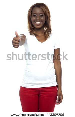 African teenage girl gesturing thumbs up isolated against white background - stock photo