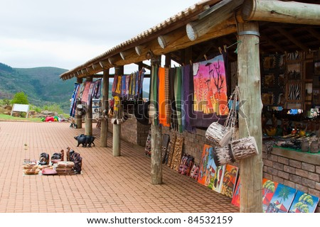 African traditional  market with handmade  souvenirs in south africa at the weekend - stock photo