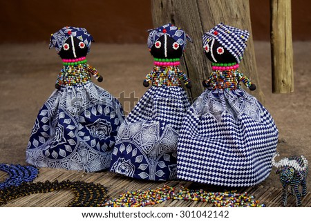 African unique rag dolls in traditional handmade colorful beads and fabrics clothes . Craftsmanship. African fashion.  Local craft market in South Africa.  - stock photo