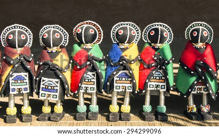 African unique traditional handmade colorful beads rag dolls. Local craft market in South Africa. - stock photo