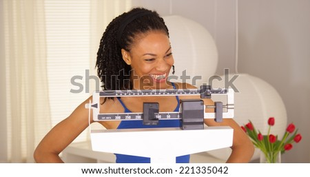 African woman feeling very proud of herself - stock photo