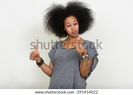 African woman giving thumbs up