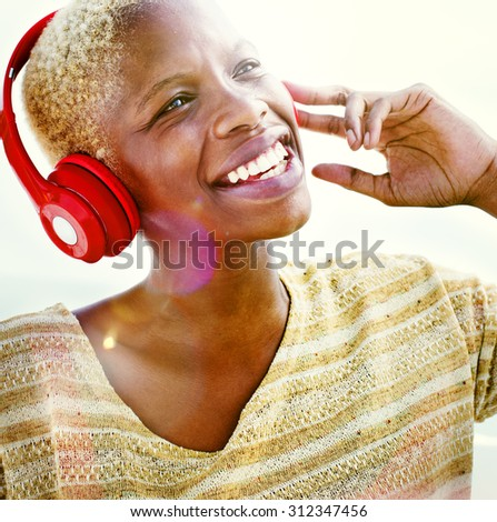 African Woman Headphones Listening Music Concept - stock photo
