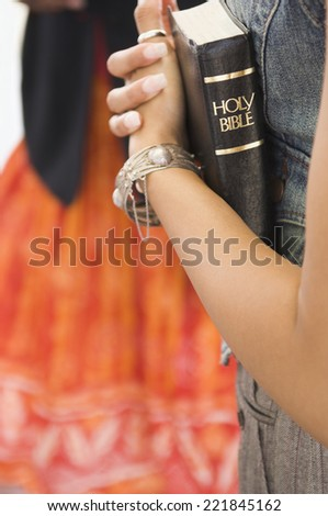 African woman holding bible - stock photo