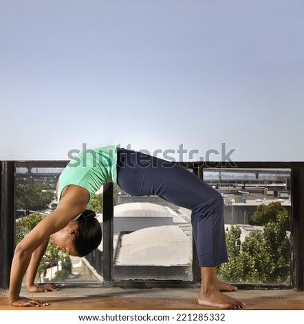 African woman practicing yoga - stock photo