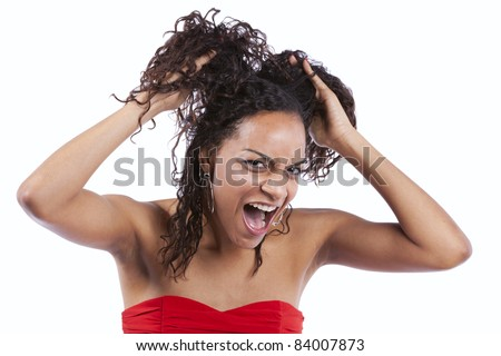 african woman pulling her hair off in stress (isolated in white) - stock photo