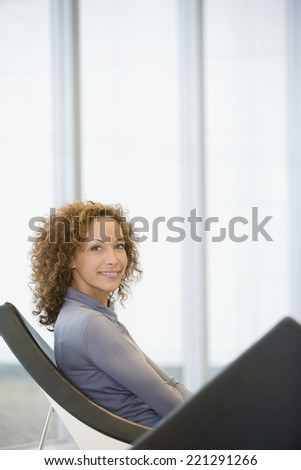 African woman sitting in chair - stock photo