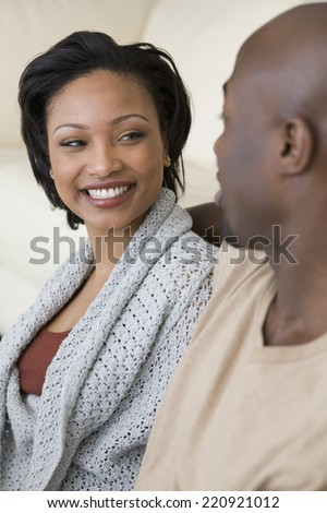 African woman smiling at husband - stock photo