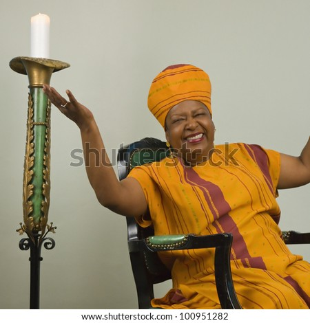 African woman smiling with arms up - stock photo