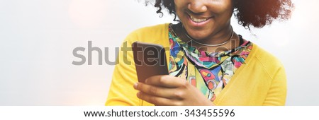 African Woman Using Mobile Phone Social Media Concept - stock photo