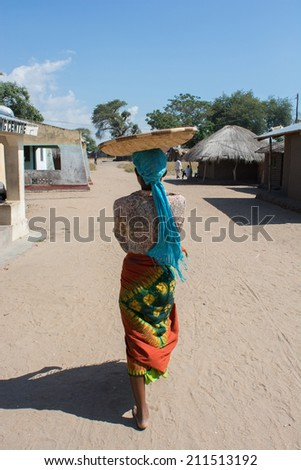 African woman with basket in head  - stock photo
