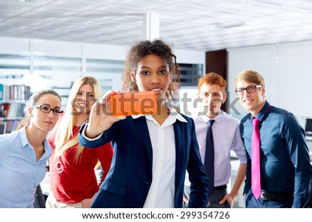 African young executive selfie self portrait multi ethnic teamwork group as leader in office - stock photo