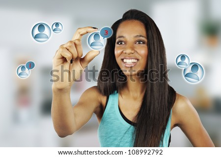 African young woman pressing Social Network icon - stock photo