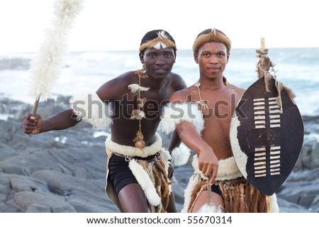 african zulu men on beach - stock photo