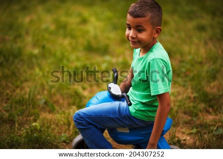 Afro American boy ride bicycles,outdoor - stock photo