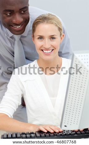 Afro-american businessman and his colleague working at a computer in the office - stock photo