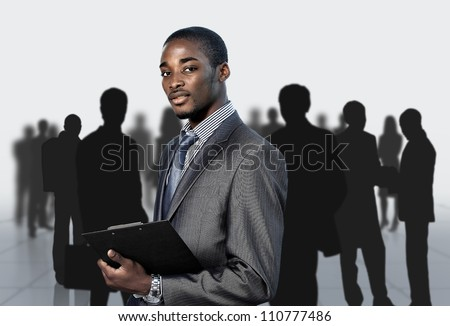 Afro-American businessman with his team - stock photo