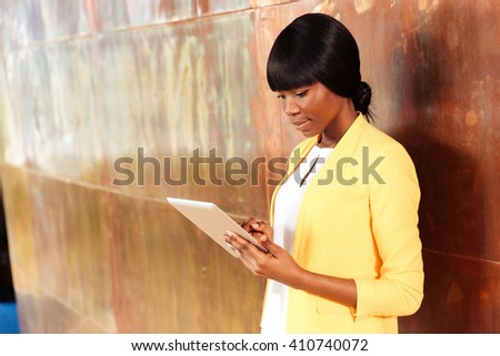 Afro american businesswoman using tablet computer - stock photo