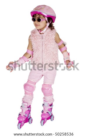 Afro american girl in a pink outfit on rollerskates - stock photo
