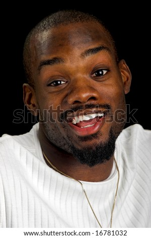 Afro-American man shrugging his shoulders. - stock photo