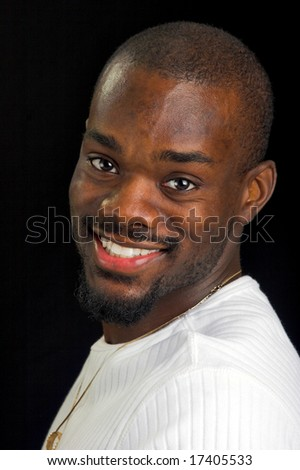 Afro-American man turned sideways and smiling. - stock photo