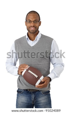 Afro-American smart young man with American football smiling at camera.? - stock photo
