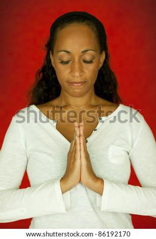 Afro-American Woman in Namaste (Yoga) - stock photo