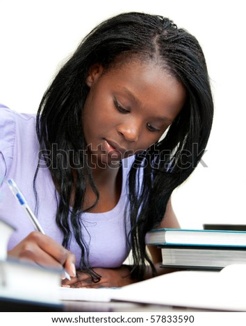 Afro-american woman studying at home - stock photo