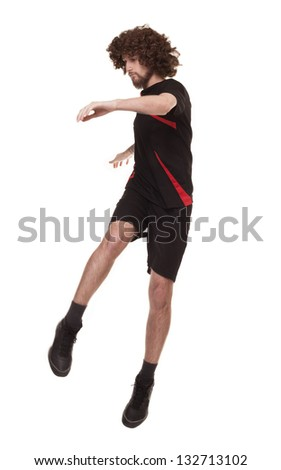 afro style haired football player jumping isolated on white background - stock photo